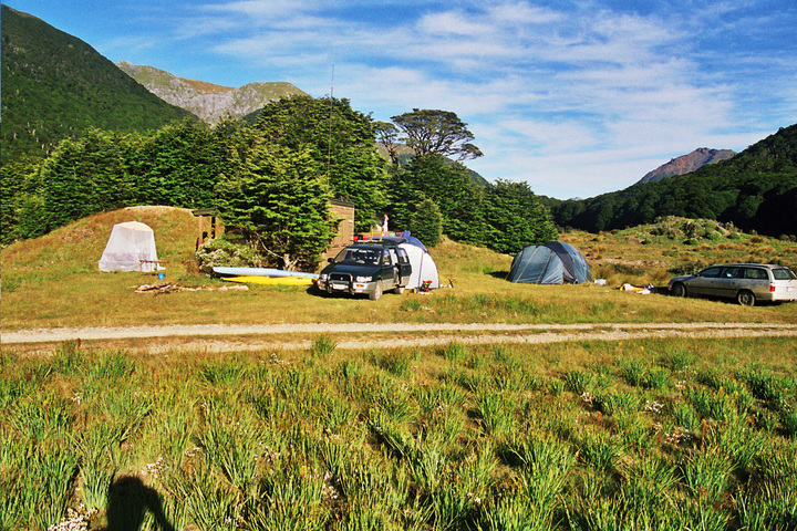 Camp next to the river at the head of the reservoir.