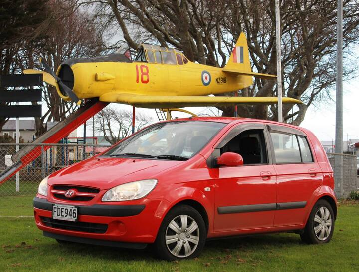Hyundai Getz Harvard aircraft Buzzy Rental Cars colours