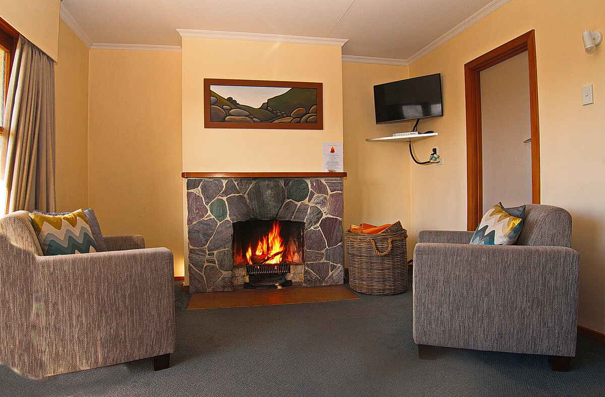 Two bedroom open fireplace during winter months.