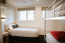 bedroom with single bed & set of bunks